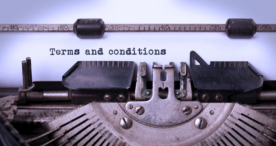 Terms and conditions being typed on typewriter